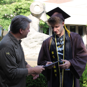 Senior Receives Diploma Before Departing for Army