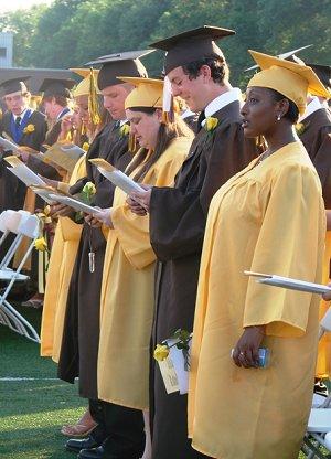 The graduates sing the Alma Mater.